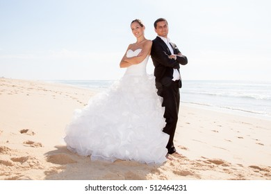 A young couple just married on a beach