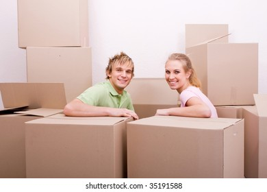 young couple just moving in to their new home