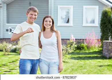 Young couple with the keys to the house