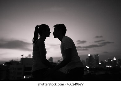 Young couple kissing in the city.