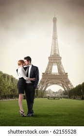 Young couple kissing with Eiffel Tower on the background