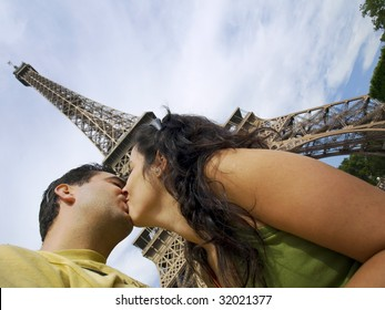 Young couple kissing with the magnificient Eiffel Tower at the background
