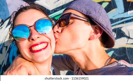 Young couple kissing on the cheek