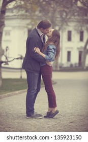Young couple kissing on the street