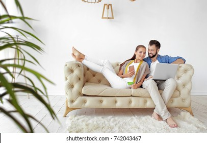 Young couple with laptop at home. Internet shopping concept
