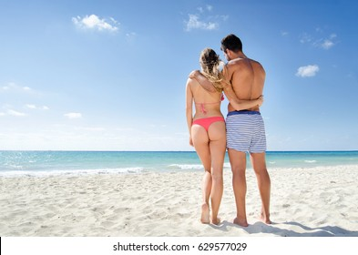 Young couple looking the beach