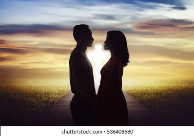 Young couple looking each other. Religious marriage concept