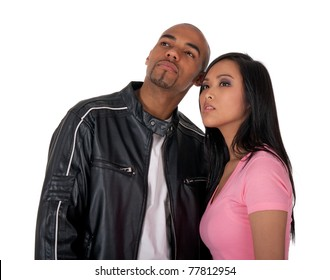 Young couple looking into the future - African American guy with Asian girlfriend.