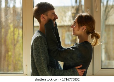 A young couple in love being at home. Loving couple spends time at home. Quarantine. Self-isolation.