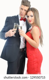 Young couple in love  celebrating with champagne