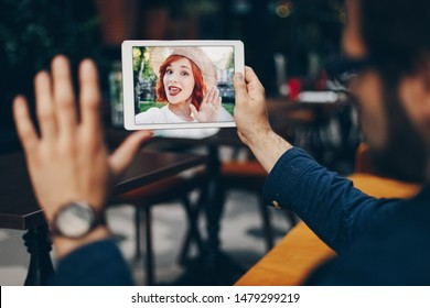 Young couple in love chatting over a video call, by using a tablet. Concept of keeping a long distance love relationship in the modern world.
