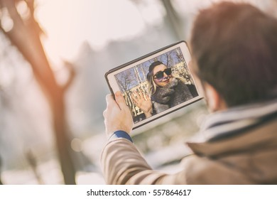 young couple in love chatting over a video call, by using a tablet. long distance relationship.