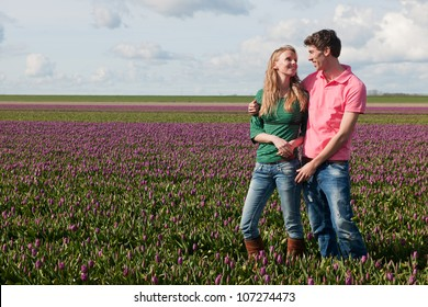 Young couple in love in Dutch flower fields