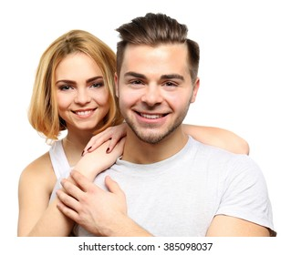 Young couple in love embracing, isolated on white