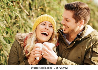 Young couple in love enjoying Christmas holidays outdoors.