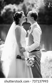 Young couple in love, groom and bride in wedding dress at the nature. Wedding Bridal bouquet