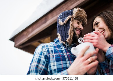 Young couple in love have fun outdoor on st valentine's day or X-mas