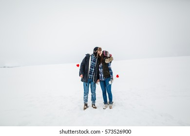 Young couple in love have fun outdoor with snow on st valentine's day or xmas