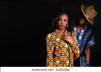 Young couple in love indoor. Portrait of young attractive couple dressed in bright national costume. Stunning sensual outdoor portrait of young stylish fashion couple posing in studio.