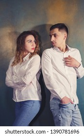 Young couple in love man and woman are offended and looking at each other,toned