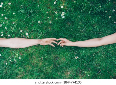 Young couple in love. Couple in love. Man and woman hands. Photo. Grass background.