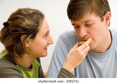 young couple in love. man and woman show their emotions. Woman feeds man