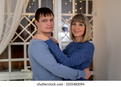 Young couple in love in mutual embrace, not background of a blurred background