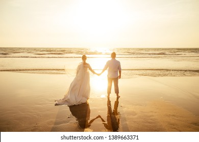 Young couple in love on the beach February 14, St. Valentine's Day sunset Goa India vacation trip .travel new year in a tropical country. freedom concept