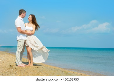 A young couple in love on the beach