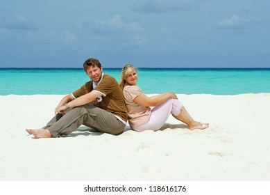 Young couple in love on white sand beach of island, Maldives
