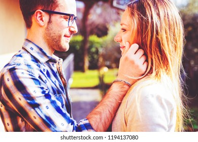 young couple in love outdoor back light looking in the eye serene - love, relationship, couple concept