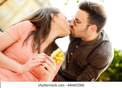 Young couple in love outdoor,kissing each other.