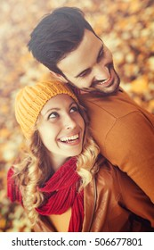 Young couple in love outdoor.Loving couple smiling and enjoying the autumn season.