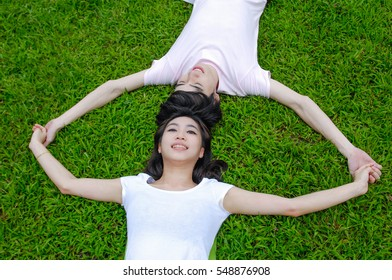 Young couple in love outdoors on grass