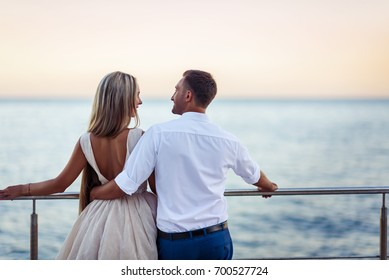 Young couple in love outdoor.Stunning sensual outdoor portrait of young stylish fashion couple posing in park