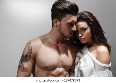 Young couple in love posing in studio.Fashion colors.