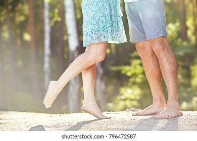 young couple in love at the rest on the nature. man and woman outdoors. legs closeup