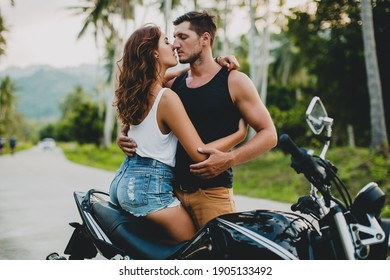 young couple in love, riding a motorcycle, hugs, passion, free spirit, vintage, hipster,