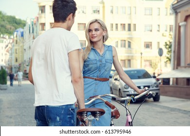 Young couple in love. Romantic encounter. Walking on bicycles.