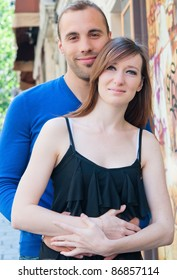 Young couple in love smiling in the streets