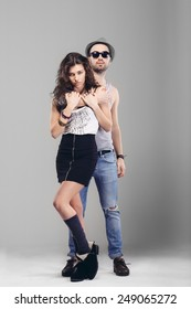 young couple in love  studio shot. Beautiful young sexy man and woman in love embracing indoor