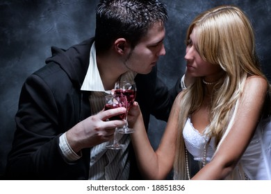 young couple in love toasting with wine