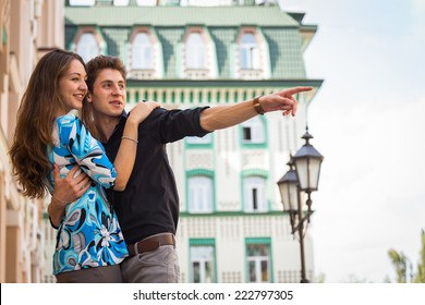 Young couple in love traveling around the beautiful city. Young people hugging and kissing on the streets.Young couple in love, hugging on the street.Happy young couple kissing on the city street.