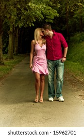 young couple in love walking and kissing
