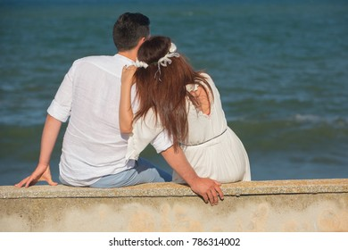 young couple in love watching the sea