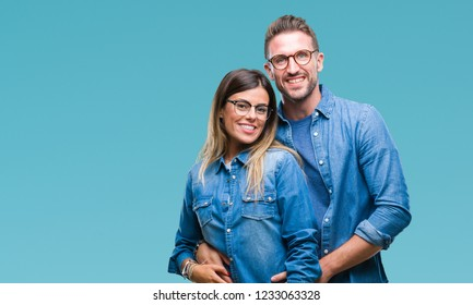 Young couple in love wearing glasses over isolated background with a happy and cool smile on face. Lucky person.