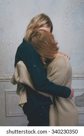 Young couple of lovers hugging goodbye