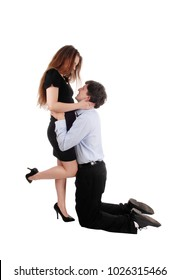 A young couple loving each other, he is kneeling for her and hugging