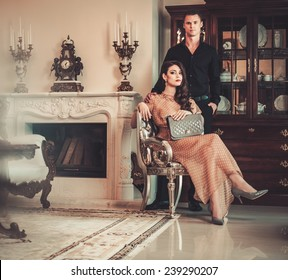 Young couple in luxury home interior