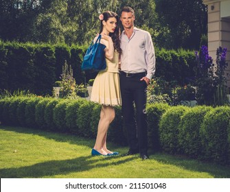 Young couple in luxury house garden